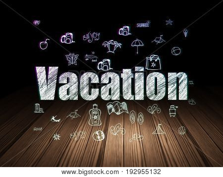 Travel concept: Glowing text Vacation,  Hand Drawn Vacation Icons in grunge dark room with Wooden Floor, black background