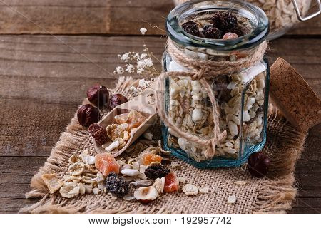 Close up image of healthy gluten free muesli with nuts seeds and dried berries over rustic wooden background. Clean eating Healthy living Vegan Vegetarian Gluten free food concept