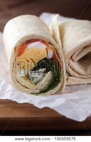 Egg Cheese And Salomon Sandwich Wrap In Tortilla