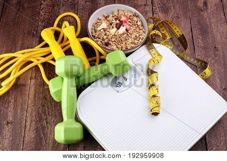 Scale With Cereals, Skipping Rope, Fruit, Strawberry, Weight And Tape Measure And Concept Of Diet An