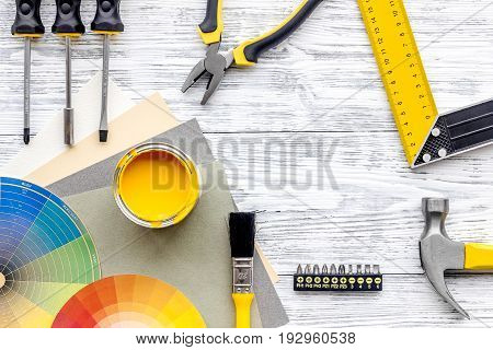 Preraring for home repair. Contruction tools on grey wooden desk background top view.