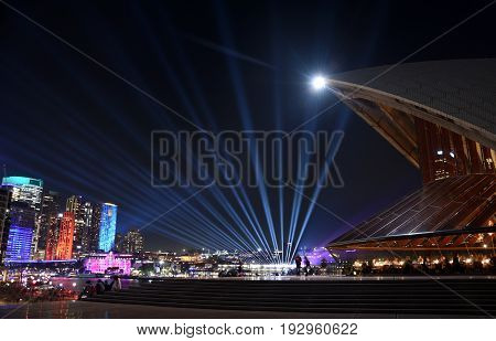 Sydney Australia - Jun 15 2017. City lights and laser show during the Sydney Vivid show the free annual outdoor event of light music and ideas. View from Sydney Opera House.