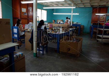 25TH AUGUST 2014 ESTELI NICARAGUA - A woman working inside a cigar factory in Esteli Nicaragua