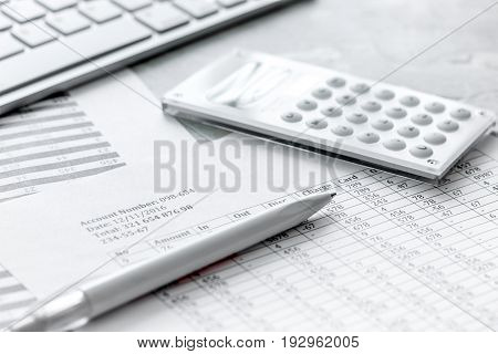 business accounter work with taxes and calculator on white office desk background