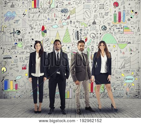 Group of successful men and women business people standing together work on a creative project. Team and corporate concept