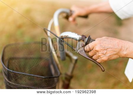 Women's Healthcare, older person, hand holding bicycle