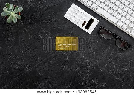 business purchasing with credit cards, keyboard on banker work desk dark background top view space for text