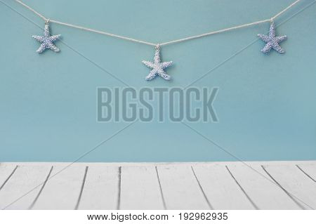 Marine Network on a wooden background. Blue starfish on a reclaimed wood background forming a beach themed border