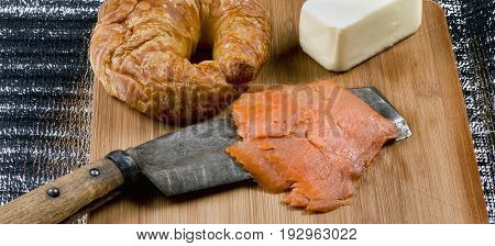 Fresh smoked lox and  a buttery croissant.