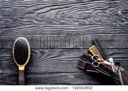 Hairdressing tools on grey wooden background top view.