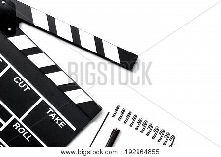 Work table of producer. Movie clapperboard and notebook on white background top view copyspace.