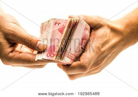 pile of chinese yuan bank note in a hand on white background
