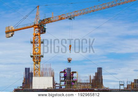 Construction Crane And Worker Of Building Industry With Blue Sky