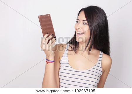 Young Woman Eating A Chocolate Bar