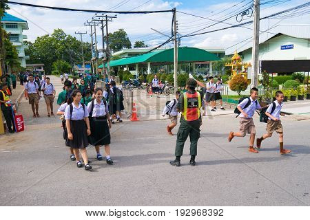Chiang Rai, Thailand - May 21, 2017 : Asian Student Walk Cross Way Safe By Reserve Officer Training