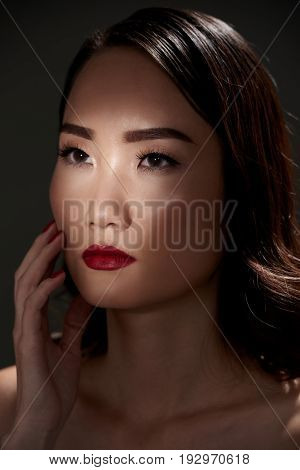 Portrait of very beautiful Asian young woman with red lips