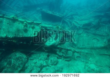 Ship wreck on botton sea carribean water. Underwater Grand Cayman island tour