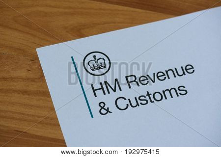 London, United Kingdom, June 28, 2017:  The logo of Her Majestys Revneue and Customs on a piece of paper. HMRC is a non-ministerial dept of the UK Government.