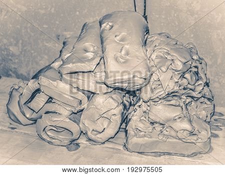 Wet white clay closeup. Abstract pieces of wet clay on the table