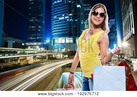 girls with shopper on a city landscape background