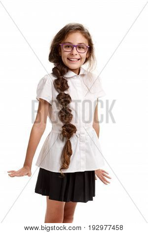 Portrait of young beautiful smiling girl in school uniform