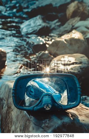 Blue Mask For Diving And Snorkel Lie On The Beach, On The Rocks, Clodeup. Tourism And Travel Concept