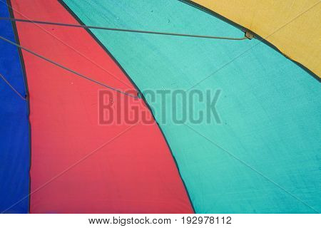 close up fabric umbrella on the beach