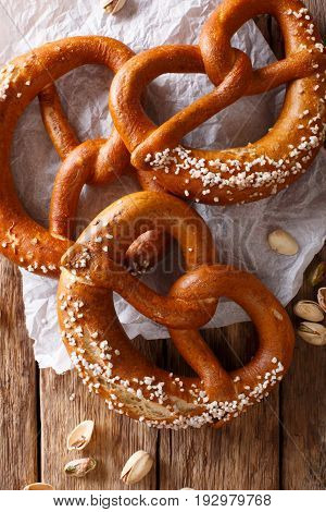 Freshly Baked Soft Pretzel With Generous Sprinkling Of Coarse Salt Close-up. Vertical Top View