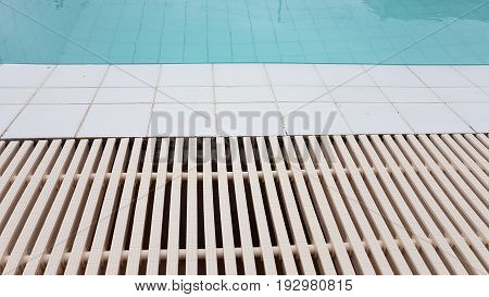 White Drainage Rail With White Tile Beside The Swimming Pool