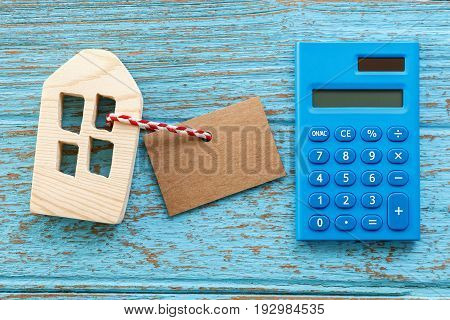 Wood House With Calculator And Blank Label