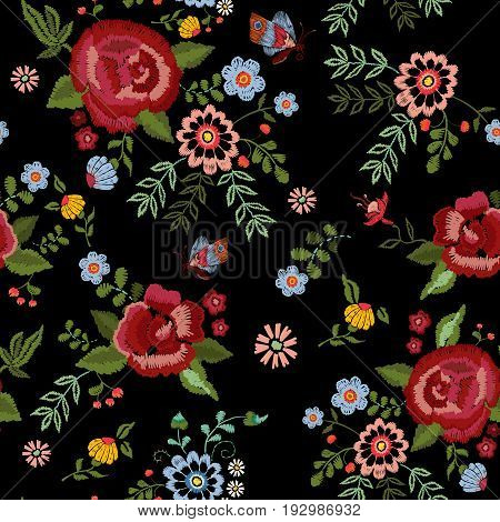 Embroidery ethnic seamless pattern with roses and fantasy flowers. Vector embroidered traditional floral design for fashion fabric.