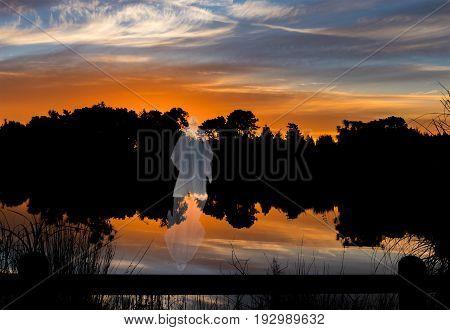 Cordyline Waters Lake with a wonderful reflection sunsetand Jesus Christ walking on water.