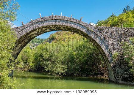 Arches stone bridge of Kalogeriko (or Plakida) on the river of Voidomatis. Central Zagoria Epirus Greece