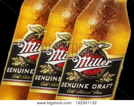 MINSK, BELARUS - JUNE 26, 2017: Miller Beer bottle isolated on black. Miller Genuine Draft is the original cold filtered packaged draft beer, a product of the Miller Brewing Company.