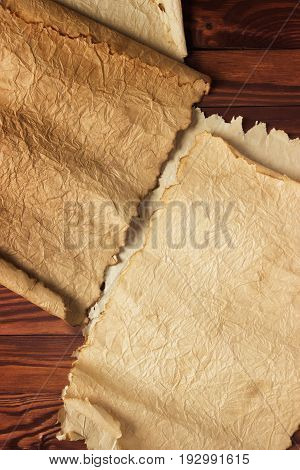 Paper Scroll On A Wooden Table, Vintage Background
