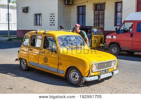 Antsiranana Madagascar - December 20 2015: Street scene with yellow taxi and policemen in Antsiranana (Diego Suarez) north of Madagascar East African Islands Africa.