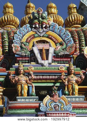 Hindu Temple Relief, Tamil Nadu, South India. South India is famous for its amazing and colourful temple pagodas and gateways. The Sri Vaishnava religion is the dominant form of the Hindu faith. The two figures are gate keepers of the temple complex, Jaya