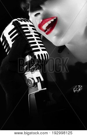 vintage blues singer singing on a 50th age mic