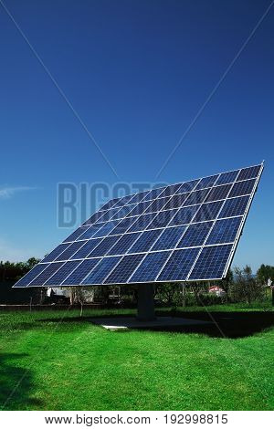 photovoltaic panels implants on the green garden