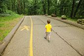 child violates the safety rules on the road. boy walking in the middle of the carriageway. kid ignores the pedestrian path. the concept of children's safety on the road poster