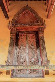 Traditional Laos style window temple Wat Si Saket in Vientiane Laos
