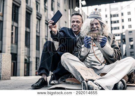 Vain Rich Man In Costume Making Selfie Of Donation Money