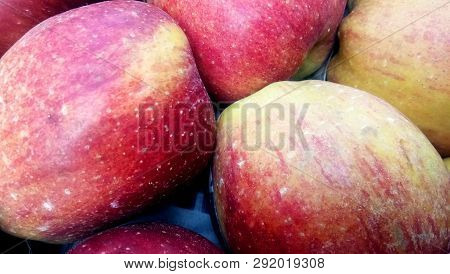 Heap Of Unwashed Unclean Red Apples In Fruit Market