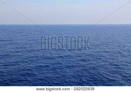 A Textured Background Of The Calm Open Water Of The Agean Sea With Plenty Of Beautiful Blue Sky And