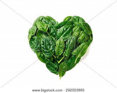 Heart Shape Made From Spinach Leaves. Spinach Pattern Isolated On White With Clipping Path. Creative