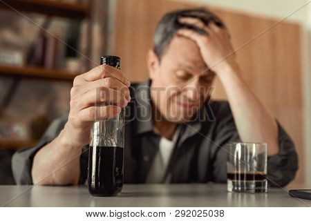 Old Man Having Life Problems And Flooding The Grief With Alcohol
