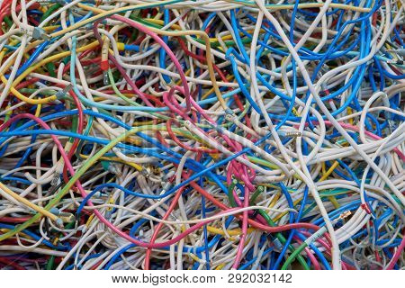 Flexible Electrical Wire Is Very Much Confusing. Cables Of Different Colors. Confusion, Chaos, Disor