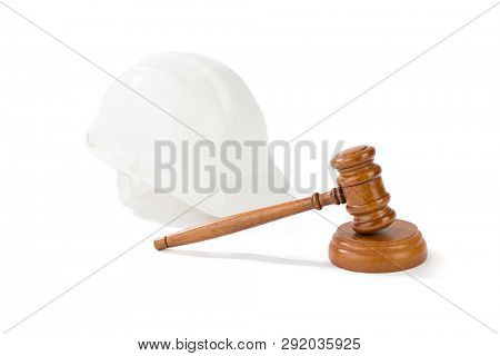 Labor law concept, wooden judge gavel and yellow helmet isolated on white background.   poster