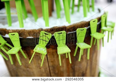 Vilnius, Lithuania - March 4, 2018: Little Green Chairs As Symbol Of Traditional Spring Fair Sold On