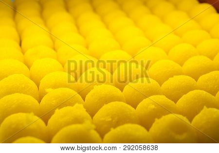 Close Up Of Sweet Yellow Balls With Lemon Flavour Displayed In Patisserie